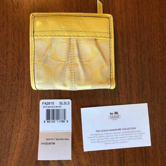 Coach Handbags - Coach mini Soho wallet canvas yellow patent
